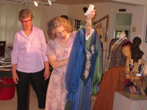 Barbara Henry and Cecilia Vore elaborating on a costume in which just one part  inspired  making of the the whole dress.