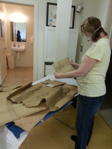 Sadie examines a sketch from the Arden Forge papers.